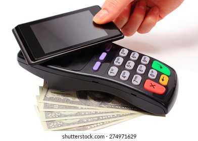Hand of woman paying with NFC technology on mobile phone, credit card reader, payment terminal with cash, finance concept