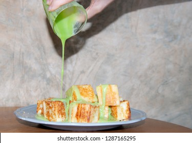 Hand woman pouring pandan mixed milk custard on stacked of grilled bread,Bread with thai pandan custard,Thai Custard Bread (Kanom Pang Sang Ka Ya) - FoodTravel,Pandan Custard Soft Bread/Bun/ Loaves