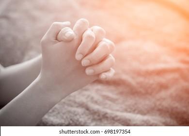 Hand of woman praying.