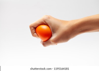 Hand of a woman squeezing a stress ball on white background