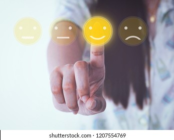 hand women pressing yellow smile buttons on virtual touch screen