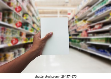 hand women shopping and  holding empty notebook for check list her buy in the supermarket