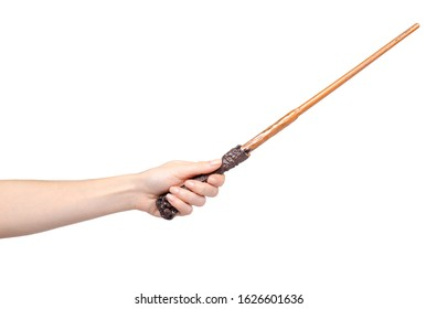 Hand with wooden magic wand, wizard and magician tool. Isolated on white background. - Shutterstock ID 1626601636