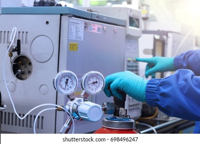 hand work and start Gas Chromatography Analyzer in laboratory