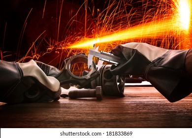 hand of worker man working by leather hand glove protection heat of splashing fire in heavy industry factory use for metal and iron industrial manufacturing theme