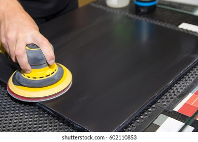 Hand of the worker is a polishing machine. Industry