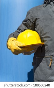 hand of worker with yellow hardhat