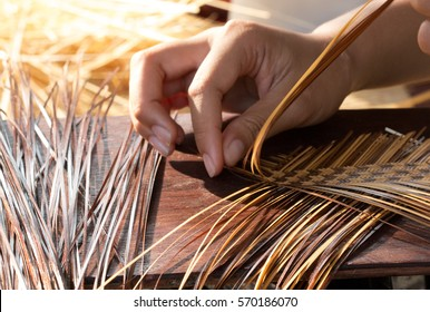 Hand working on bamboo weaving. Thailand