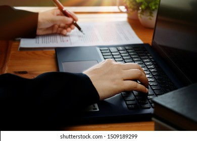 hand working on editing blur text with pen and computer on desk in office