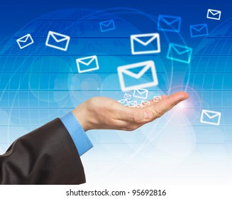 Hand with world mail delivery on map background