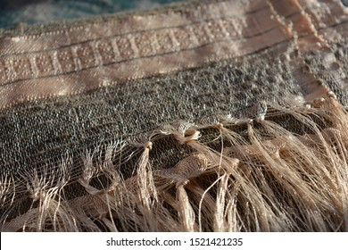 Hand  woven, hand dyed silk pashmina detail, selective focus on fringe knots