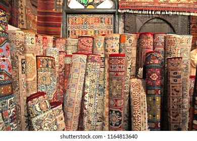 Hand woven morrocan carpets displayed in a marketplace