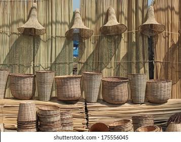 Hand woven straw baskets hang for sale in a public market near Nairobi Kenya