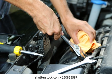 Hand with wrench. Auto mechanic in car repair
