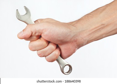 Hand with a wrench on a white background