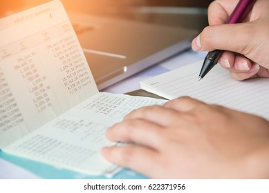 Hand write on note book with text interest with account bank book