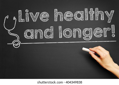 "Hand writes ""Live healthy and longer!"" on blackboard"