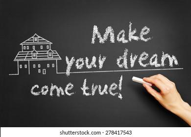 "Hand writes ""Make your dream come true!"" on blackboard"