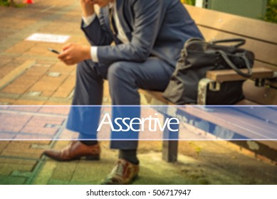 Hand writing assertive  with the abstract background. The word assertive   represent the action in business as concept in stock photo.