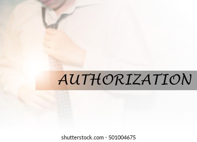 Hand writing AUTHORIZATION with the young business man on background. Business concept. Stock Photo.