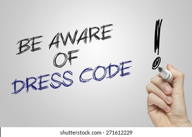 Hand writing be aware of dress code on grey background
