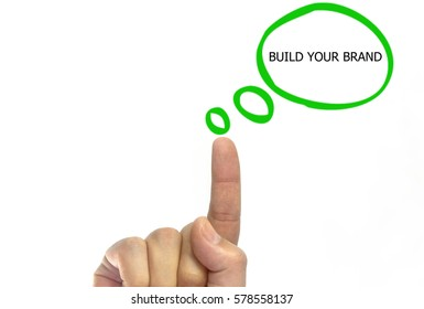 Hand writing BUILD YOUR BRAND with marker on talk bubble