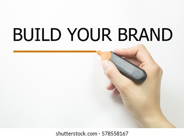 Hand writing BUILD YOUR BRAND with marker
