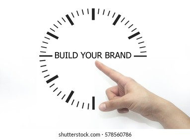 Hand writing BUILD YOUR BRAND, woman hand on transparent wipe board.