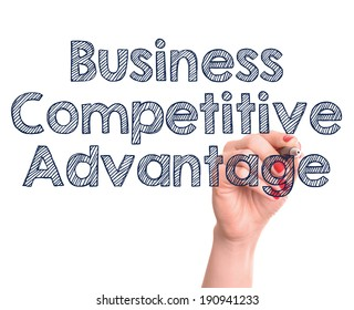 Hand writing business competitive advantage with marker on transparent wipe board.