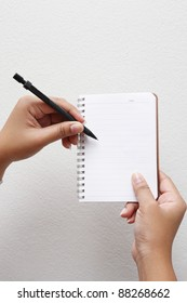 hand writing by pencil on notebook