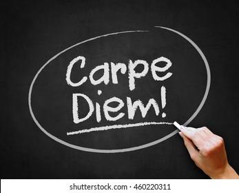 A hand writing 'Carpe Diem!' on chalkboard.