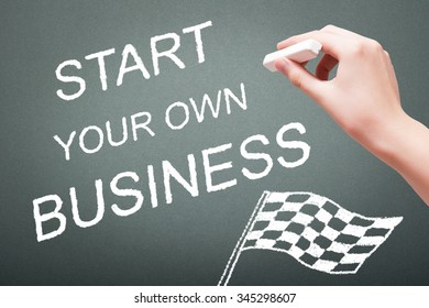 Hand writing with chalk start your own business concept on blackboard