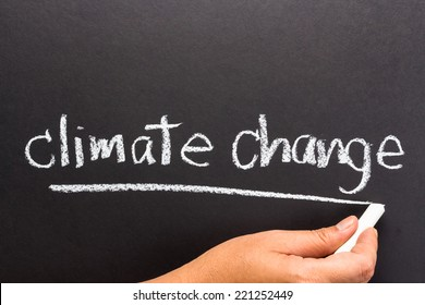 Hand writing Climate change topic on chalkboard