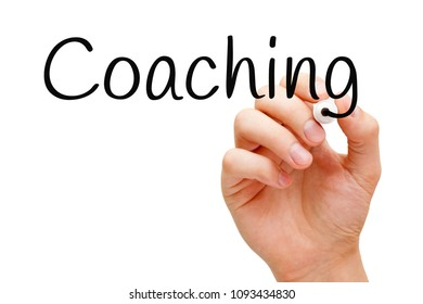 Hand writing Coaching with black marker on transparent wipe board.