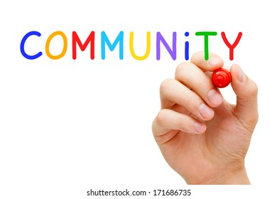 Hand writing Community with marker on transparent wipe board.