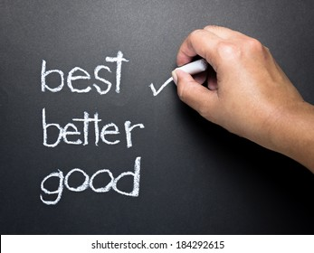 Hand writing correct mark with chalk on the best choice