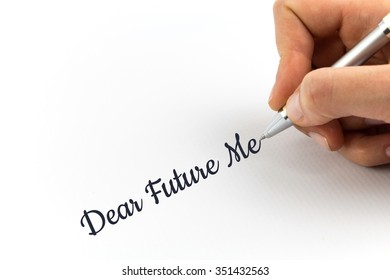 """Hand writing """"Dear Future Me"""" on white sheet of paper."""