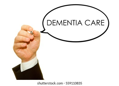 Hand writing DEMENTIA CARE word on a transparent wipe board.
