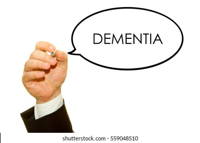 Hand writing DEMENTIA word on a transparent wipe board.