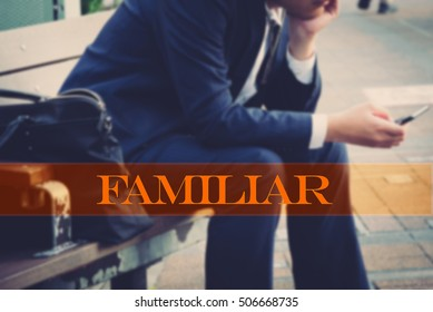Hand writing familiar with the abstract background. The word familiar  represent the action in business as concept in stock photo.