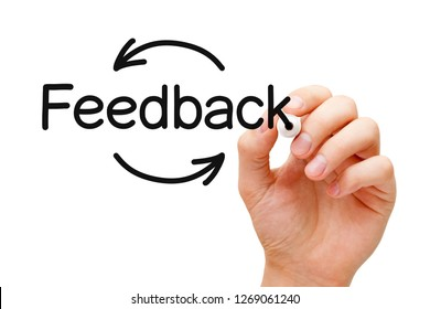 Hand writing Feedback cycle arrows concept with black marker on transparent wipe board isolated on white.