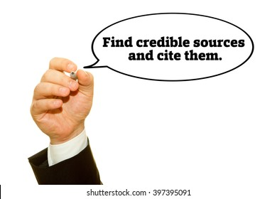 """Hand writing """"Find credible sources and cite them"""". on a transparent wipe board."""