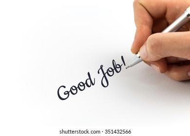 "Hand writing ""Good Job"" on white sheet of paper."
