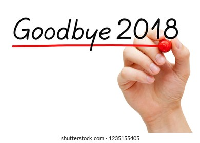 Hand writing Goodbye year 2018 with marker on transparent glass board isolated on white.