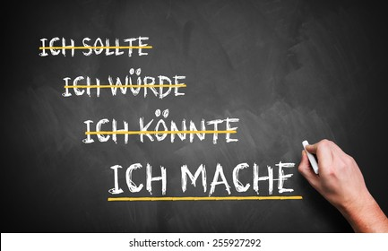 hand is writing 'I should, I could, I would, I do' in German