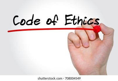 Hand writing inscription code of ethics with marker, concept