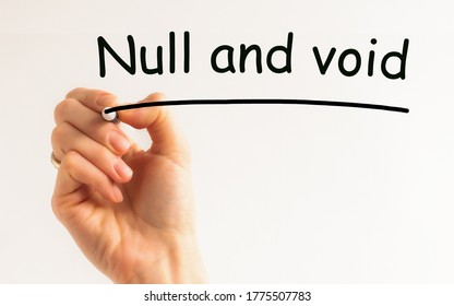 Hand writing inscription - null and void - with marker, concept, the letters in black