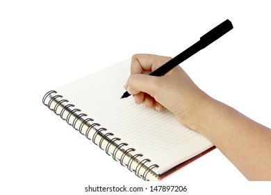 Hand is writing into blank notebook, isolated