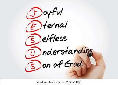 Hand writing JESUS - Joyful Eternal Selfless Understanding Son of God, acronym concept with marker