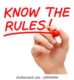 Hand writing Know The Rules with red marker on transparent wipe board.
